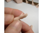 Shaping the thumb into position to create a natural look of the polymer clay hand